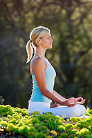 Woman performs yoga in Makena, Maui.
