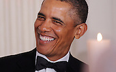 United States President Barack Obama laughs during the National Governors Association 2013 Black-tie Dinner in the State Dining Room of the White House in Washington, D.C., February 24, 2013. .Credit: Olivier Douliery / Pool via CNP