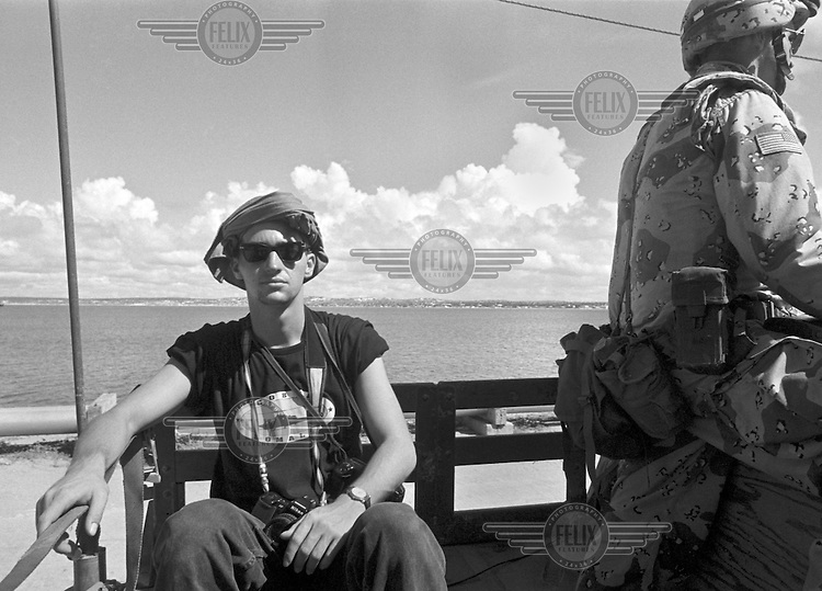 Freelance photojournalist Dan Eldon photographed in a U.S. Humvee military vehicle near Mogadishu, Somalia on April 20, 1993. Dan Eldon was killed in Mogadishu on June 12, 1993, along with fellow journalists Hansi Krauss, Hos Mania and Anthony Macharia. He was 22 years old.