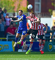 Lincoln City's Cian Bolger battles with Tranmere Rovers' James Norwood<br /> <br /> Photographer Andrew Vaughan/CameraSport<br /> <br /> The EFL Sky Bet League Two - Lincoln City v Tranmere Rovers - Monday 22nd April 2019 - Sincil Bank - Lincoln<br /> <br /> World Copyright © 2019 CameraSport. All rights reserved. 43 Linden Ave. Countesthorpe. Leicester. England. LE8 5PG - Tel: +44 (0) 116 277 4147 - admin@camerasport.com - www.camerasport.com