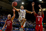 BROOKINGS, SD - DECEMBER 31:  Andre Wallace #20 from South Dakota State University takes the ball to the basket between Tyler Peterson #22 and Triston Simpson #3 from the University of South Dakota during their game Saturday afternoon at Frost Arena in Brookings. (Dave Eggen/Inertia)