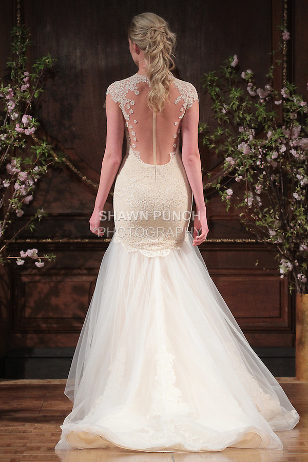 """Model walks runway in a """"Toni"""" bridal gown from the Isabelle Armstrong Spring Collection 2017, at Lotte New York Palace Hotel, during New York Bridal Fashion Week Spring Summer 2017 on April 16, 2017."""