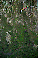 BLOUKRANS BRIDGE, SOUTH AFRICA, DECEMBER 2004. The Bloukrans bridge bungy jump, the highest commercial jump in the world, drops you 216 meters before you bounce back up. South African Nature offers some of the world's best adrenaline sports and outdoor challenges. Photo by Frits Meyst/Adventure4ever.com