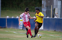 Otesha Charles of Watford Ladies holds off Hollie Jardine of Stevenage Ladies during the pre season friendly match between Stevenage Ladies FC and Watford Ladies at The County Ground, Letchworth Garden City, England on 16 July 2017. Photo by Andy Rowland / PRiME Media Images.