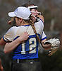 Heather Berberich #12, Calhoun shortstop congratulates pitcher Meghan Vecchione #6 after her 9-0 shutout over Baldwin in a Nassau AA-I/AA-II crossover game at Calhoun High School on Saturday. April 14, 2018. Vecchione struck out 15 batters in the win.