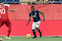 FOXBOROUGH, MA - AUGUST 31: Cristian Penilla #70 of New England Revolution dribbles during a game between Toronto FC and New England Revolution at Gillette Stadium on August 31, 2019 in Foxborough, Massachusetts.
