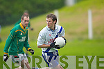 3321 -  Finuges Vincent Murphy chasing down St Marys Conor Galvin in the Division 2 League clash in Finuge on Saturday ..