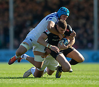 Exeter Chiefs' Ollie Devoto is tackled by Bath Rugby's Zach Mercer<br /> <br /> Photographer Bob Bradford/CameraSport<br /> <br /> Premiership Rugby Cup - Exeter Chiefs v Bath Rugby - Sunday 24th March 2019 - Sandy Park - Exeter<br /> <br /> World Copyright © 2018 CameraSport. All rights reserved. 43 Linden Ave. Countesthorpe. Leicester. England. LE8 5PG - Tel: +44 (0) 116 277 4147 - admin@camerasport.com - www.camerasport.com