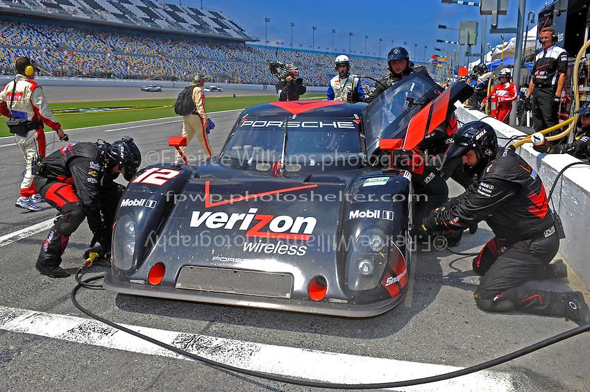 4 July, 2009, Daytona Beach, Florida USA.#12 Penske Racing Porsche/Riley of Timo Bernhard & Romain Dumas makes a pit stop..©2009 F.Peirce Williams, USA.