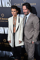 Keanu Reeves &amp; Ruby Rose at the premiere of &quot;John Wick Chapter Two&quot; at the Arclight Theatre, Hollywood. <br /> Los Angeles, USA 30th January  2017<br /> Picture: Paul Smith/Featureflash/SilverHub 0208 004 5359 sales@silverhubmedia.com