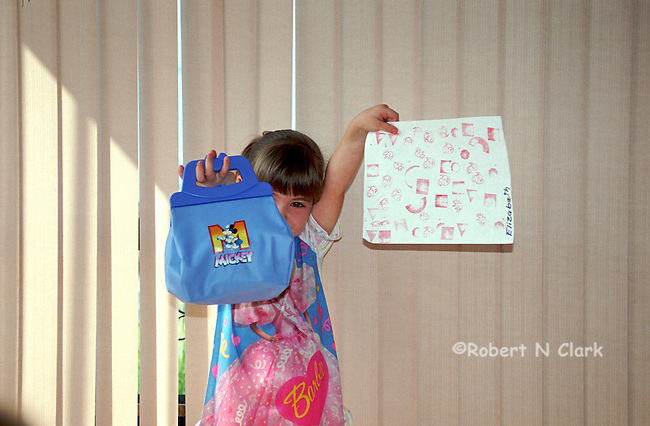 Girl showing off her new Mickey Mouse bag
