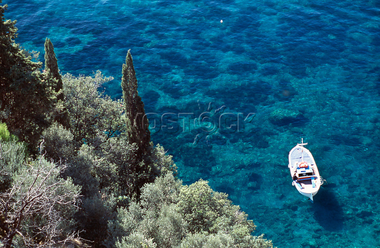 View of boat in water off coastline, aerial view