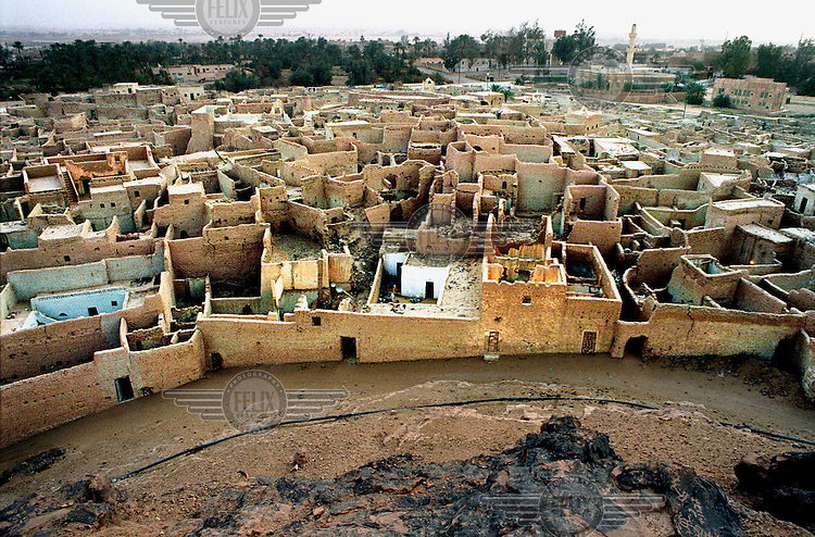 Photo: Sven Torfinn.Libya, Ghat, 1999.Southern Libya, view at the old town, old city centre, Medina, used to be an important destination for the camel caravans which .made up the trans Sahara trade, nowadays a tourist destination, history.