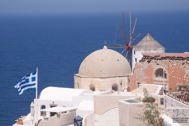 Downward view of Windmill, church and Greek Flag