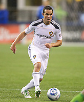 L.A. Galaxy defender Todd Dunivant dribbles the ball up field during play against the Seattle Sounders FC at Qwest Field in Seattle Tuesday March 15, 2011. The Galaxy won the game 1-0.