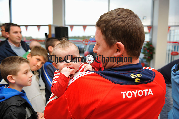 Amelia Hardiman with her dad Darren  during the visit of the Heineken Cup to Tom Hogan Motors Toyota centre, Ennis, on Monday evening. Photograph by John Kelly.