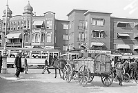 Photo from the NIOD's Huizinga collection. A German soldier takes a load of food with horse and cart, corner Reinkenstraat-Laan van Meerdervoort, The Hague Menno Huizinga was part of the Hidden Camera and made illegal photos during the occupation. He did this mainly in his hometown The Hague.