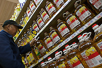 Soy bean oil being sold in the Tesco China's HY Mall in Shanghai, China. Tesco now effectively has 45 HY Mall stores across China. The supermarket chain is wooing Chinese shoppers with a mix of Chinese market insight and British retailing expertise..06 May 2007