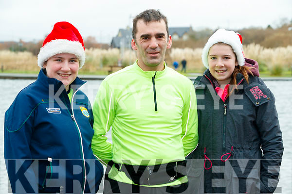 Muireann Dowling,(Listowel), David Walsh (Tralee) and Ciara O'Sullivan (Finuge), who took part in the Santa Run at Tralee Bay Wetlands on Sunday morning last.