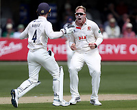 Simon Harmer of Essex celebrates with Robbie White having taken the wicket of Tom Moores during Essex CCC vs Nottinghamshire CCC, Specsavers County Championship Division 1 Cricket at The Cloudfm County Ground on 16th May 2019