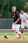 Palos Verdes, CA 01/22/13 - Dane Silverlake  (West Torrance #13) and Imahn Moshksar (Peninsula #12) in action during the West vs Peninsula boys varsity soccer game at Peninsula High School.