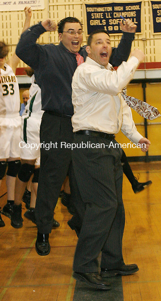 Holy Cross Coach celebrates his teams victory over East Catholic in Class M semi final action at Southington High School Tuesday night.  The Crusaders proceed to the next round with their win over the Eagles 54-5  Michael Kabelka Republican / American.