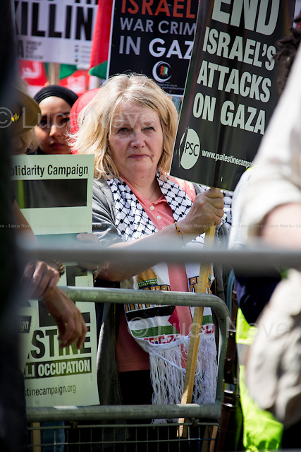 London, 26/07/2014. A week after the c.100,000 people who marched from 10 Downing Street to the Israeli Embassy, today another national demonstration saw tens of thousands of people taking to the street of central London in support and solidarity with Gaza's population, battered by an 18-day long campaign of Israeli sea/air bombardments and by the terrestrial invasion. The number of Palestinians killed during the Israeli raids overtook 1000 people including a large number of children, and thousands of injured people. After gathering outside the Israeli embassy in High Street Kensington, the sea of people marched through central London, ending in Parliament Square. The march was organised by, amongst others, War On Want, Stop The War Coalition, London Palestine Action, FOA - Friends of Al Aqsa, PSC - Palestine Solidarity Campaign, BMI - British Muslim Initiative, Palestinian Forum in Britain, and Campaign for Nuclear Disarmament.