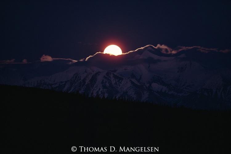 Moonrise above the Alaska Range in Denali National Park, Alaska.