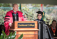 President Jonathan Veitch confers emeritus status to retiring professor Phoebe Dea at Occidental College's 133rd Commencement at the Remsen Bird Hillside Theater, on Sunday, May 17, 2015.<br /> (Photo by Marc Campos, Occidental College Photographer)