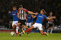 Christian Burgess of Portsmouth right fouls Jordan Hulme of Altrincham  and a penalty is given during Portsmouth vs Altrincham, Emirates FA Cup Football at Fratton Park on 30th November 2019