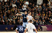 CARSON, CA - MARCH 07: Adnan #53 of the Vancouver Whitecaps and Rolf Feltscher #25 of the LA Galaxy go high for a ball during a game between Vancouver Whitecaps and Los Angeles Galaxy at Dignity Health Sports Park on March 07, 2020 in Carson, California.