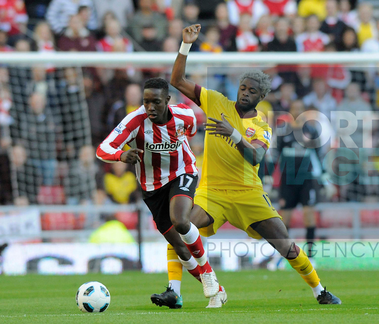 Sunderland's Danny Welbeck and Arsenal's Alex Song.