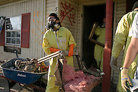 New Orleans, LA--Members of Peace Lutheran Campus Centre, a Wisconsin-based church group,  clearing debris out of a ruined home in the Chalmette region of New Orleans.Liam Maloney / Special to The Gazette