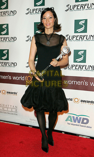 LUCY LIU.The 2006 Women's World Awards - Press Room held at the Hammerstein Ballroom, New York City, New York, USA, 14th October 2006..full length black sheer dress holding award trophy.Ref: ADM/JL.www.capitalpictures.com.sales@capitalpictures.com.©Jackson Lee/AdMedia/Capital Pictures.