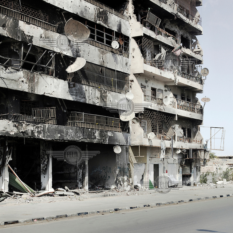 A shelled, burnt and destroyed building on Tripoli street in Mizrata.