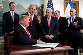 Prime Minister of Israel Benjamin Netanyahu (Back C) holds up the pen used by US President Donald J. Trump (Front C) to sign an order recognizing Golan Heights as Israeli territory, in the Diplomatic Reception Room of the White House in Washington, DC, USA, 25 March 2019.<br /> Credit: Michael Reynolds / Pool via CNP