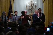United States Vice President Mike Pence embraces a woman after she led a prayer at the Young Black Leadership Summit in the East Room of the White House in Washington D.C., U.S. on October 4, 2019.<br />  <br /> Credit: Stefani Reynolds / CNP