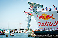 An estimated 75,000 fans cheered as 34 costumed-teams from throughout the Southeast took turns launching outrageously-designed homemade flying machines from a 30-foot ramp, in an attempt to soar the greatest distance before plunging into the tropical waters of Biscayne Bay during the Red Bull Flugtag challenge at Bayfront Park, Miami, Florida, USA, Saturday, July 10, 2010..The quirky crafts and teams were judged on flight distance, creativity and showmanship ....German for 'flying day' the first Red Bull Flugtag event was held in Vienna, Austria, 1991... setting the flight record in 2000 at 195 feet... Flugtag Nashville set a U.S. record with a flying banjo, at 155 feet... the 2004 Flugtag Miami flight record, 33 feet... Photos by Debi Pittman Wilkey