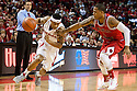 December 14, 2013: Deverell Biggs (1) of the Nebraska Cornhuskers driving to the hoop against Rakeem Dickerson (1) of the Arkansas State Red Wolves at the Pinnacle Bank Areana, Lincoln, NE. Nebraska defeated Arkansas State 79 to 67.
