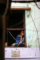 23.10.2006 Varanasi(Uttar Pradesh)<br /> <br /> Women looking through the window.<br /> <br /> Femme regardant a travers la fenetre.