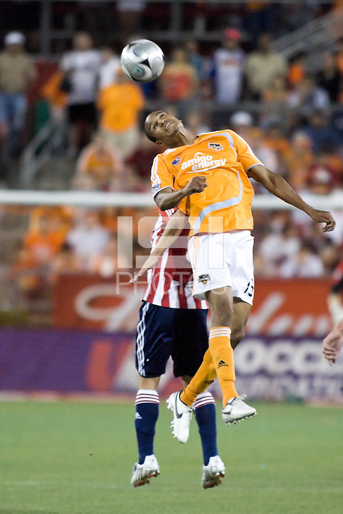 Houston Dynamo midfielder Ricardo Clark (13)  goes up for the header.  The Houston Dynamo tied CD Chivas USA 0-0 at Robertson Stadium in Houston, TX on May 3, 2008.