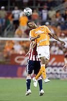 Houston Dynamo midfielder Ricardo Clark (13)  goes up for the header.  The Houston Dynamo tied CD Chivas USA 0-0 at Robertson Stadium in Houston, TX on May 3, 2008.