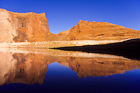 A rock reflection in calm water in The Lake Povel water resavour behind Glen Canyon Dam, Utah, USA