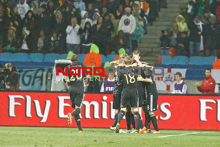 Team members celebrate a goal during the FIFA World Cup 2010 3rd Place Play off match between Uruguay and Germany held at The Nelson Mandela Bay Stadium  in Port Elizabeth, South Africa on the 10 July 2010<br /> <br /> <br />  <br /> <br /> Foto &copy;  nph /  Kokenge *** Local Caption *** Fotos sind ohne vorherigen schriftliche Zustimmung ausschliesslich f&uuml;r redaktionelle Publikationszwecke zu verwenden.<br /> <br /> Auf Anfrage in hoeherer Qualitaet/Aufloesung