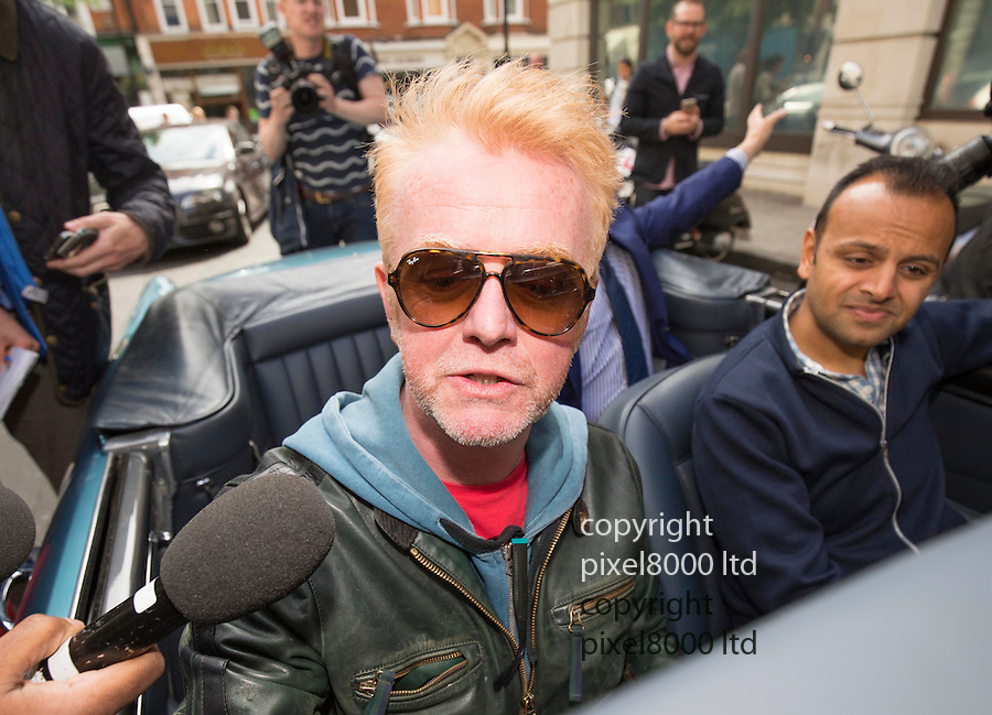 Pic shows: Media frenzy as new Top Gear host and Radio 2 presenter Chris Evans leaves the BBC in London today in his vintage Aston Martin car.<br /> <br /> <br /> <br /> <br /> Pic by Gavin Rodgers/Pixel 8000 Ltd