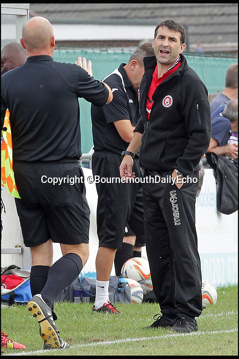 BNPS.co.uk (01202 558833)<br /> Pic: RichardCrease/BNPS<br /> <br /> Poole Town boss Killick remonstrates with a linesman before his 6 game ban. <br /> <br /> Enterprising home boss Tommy Killick watches the game from the attic window of his groundsman's house, after receiving a 6 match ban from the dugout.