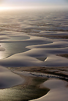Late afternoon aerial of Lencois Maranhenses, an extensive dune system with pools of water between the dunes in Maranhao State in northeastern Brazil (Nordeste)