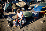 RENO, NV - OCTOBER 6:  Marian Schamp takes a break from moving her possessions as a tent city for the homeless in downtown Reno, Nevada is consolidated on October 6, 2008. The City of Reno set up the tent city when existing shelters became overcrowded as Nevada struggles with one of the highest unemployment rates in the country.