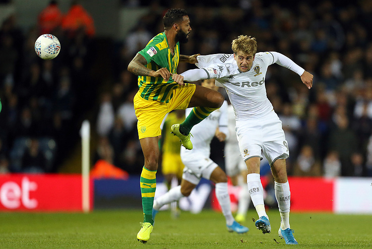 Leeds United's Patrick Bamford battles with West Bromwich Albion's Kyle Bartley<br /> <br /> Photographer Rich Linley/CameraSport<br /> <br /> The EFL Sky Bet Championship - Tuesday 1st October 2019  - Leeds United v West Bromwich Albion - Elland Road - Leeds<br /> <br /> World Copyright © 2019 CameraSport. All rights reserved. 43 Linden Ave. Countesthorpe. Leicester. England. LE8 5PG - Tel: +44 (0) 116 277 4147 - admin@camerasport.com - www.camerasport.com