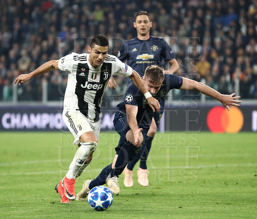 Football Soccer: UEFA Champions League -Group Stage-  Group H - Juventus vs Manchester United, Allianz Stadium. Turin, Italy, November 07, 2018.<br /> Juventus' Cristiano Ronaldo (l) in action with Manchester United's Luke Shaw (r) uring the Uefa Champions League football soccer match between Juventus and Manchester United at Allianz Stadium in Turin, November 07, 2018.<br /> UPDATE IMAGES PRESS